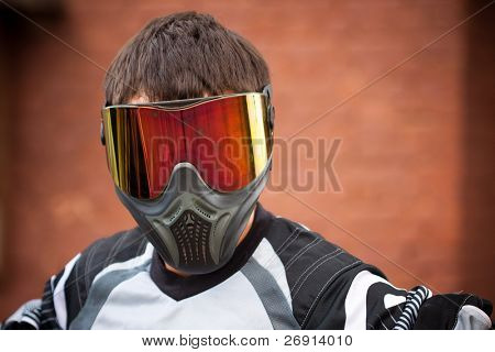 man wearing a paintball mask