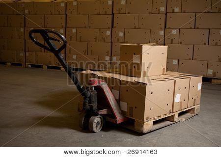 cajas por lado Transpaleta