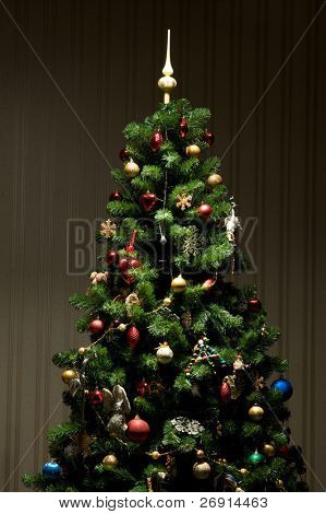 Christmas-tree with multitude of decorations