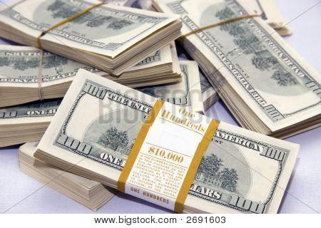 Table Full Of $100 Dollar Bills