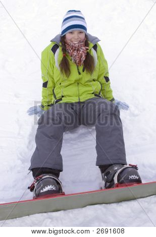 A Health Lifestyle Image Of Young Adult (Age 18-20) Snowboarder Girl After Incidence