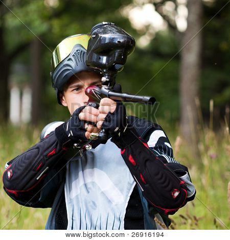 paintball shooter aiming the gun