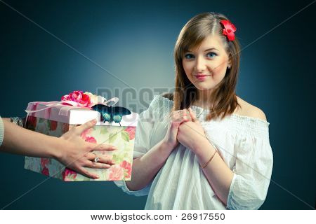 beautiful young woman receives a gift