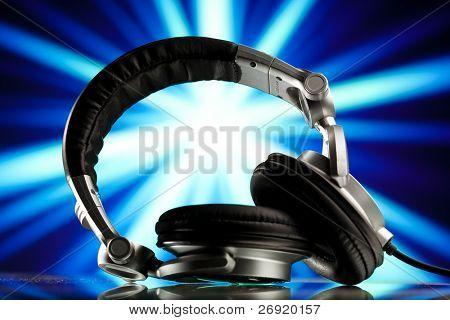 headphones against blue rays background