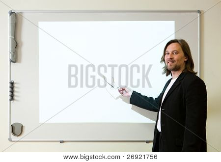 man making a presentation with empty projector screen