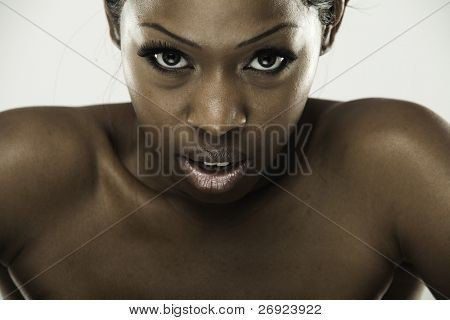 beautiful African woman with long false eyelashes and natural make-up