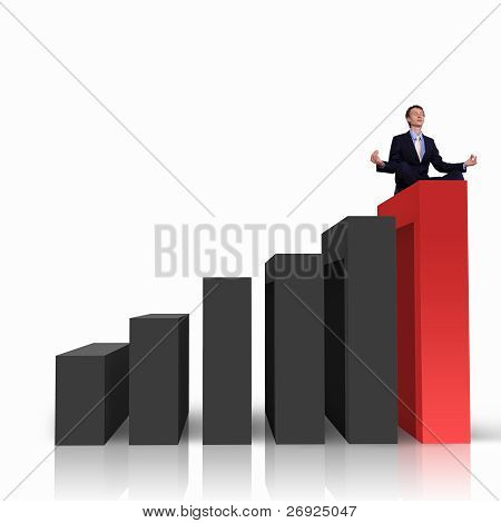 Businessman on Top of financial charts