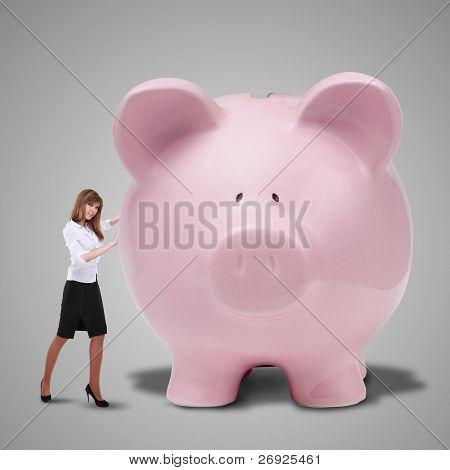 Piggybank and young business man