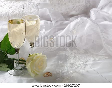 wineglass,rose and gold rings on the dress