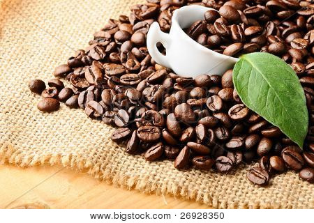 white cup with coffee beans