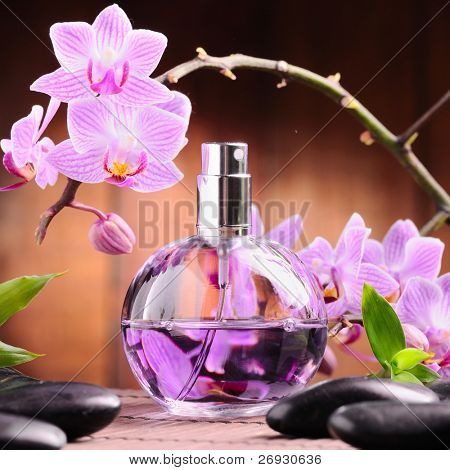 orchid and perfume bottle