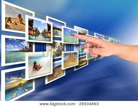 Mujer mano elegir unas vacaciones - vienen todas las fotos de mi Galería