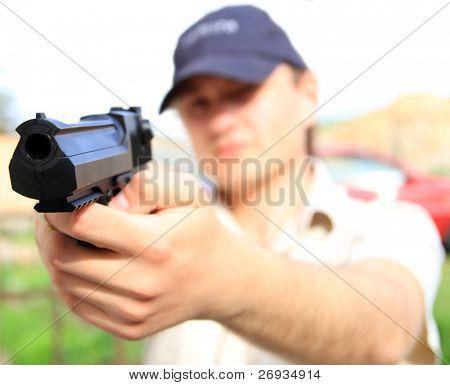 Young man holding gun