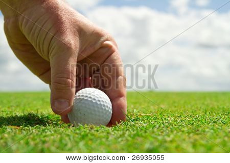 Taking golf ball from the hole
