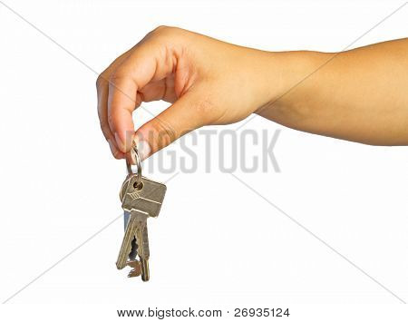 Woman hand with keys to new house