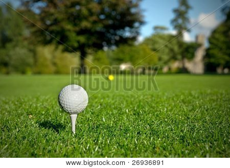 Golf ball on tee in a beautiful golf club
