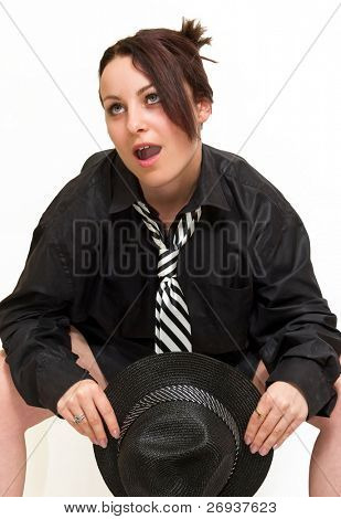 Young women posing on office chair with the hat