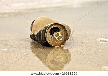 Metallic can trash on the beach