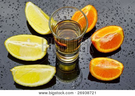 Gold tequila with orange and lemon sliced