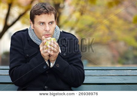 Man In Autumn Drinks Tea