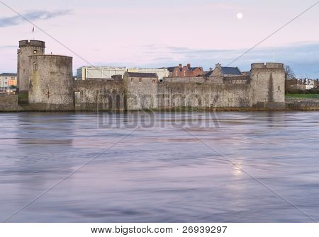 King John castle in Limerick with full moon - Ireland