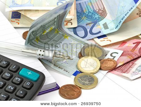 Home budget counting with calculator and pen