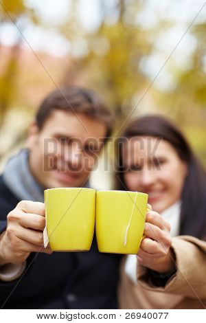 Raising Glasses With Tea