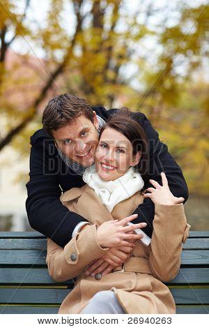 Man Hugging Woman In Park