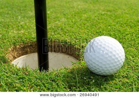 Golf ball just near the hole