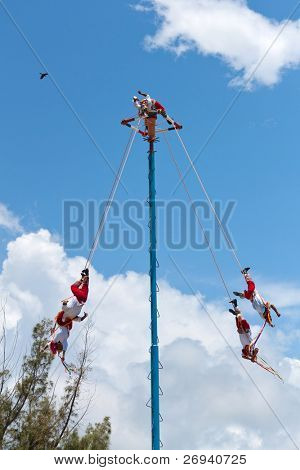 "TULUM, MEXICO - JULY 15: Unkown Voladores men at ""Flying Men Dance"" ceremony. The ritual pleased the rain god Xipe Totec and was started in 5th Century. July 15, 2011 in Tulum, Quintana Roo, Mexico"