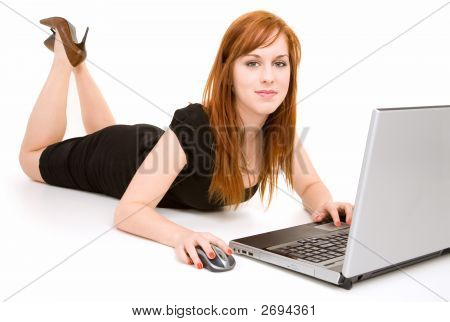 Young Redhead Woman Lying Down Using Laptop