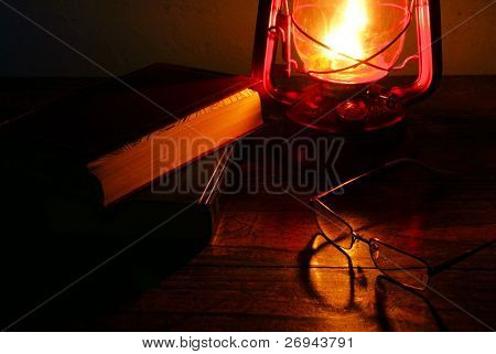 Paraffin lamp and books