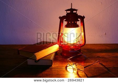 Books and hurricane lantern