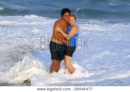 Inter-ethnic couple at seaside