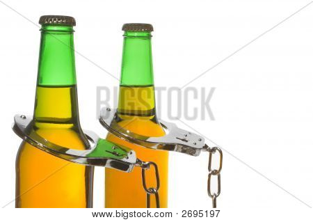 Beer And Handcuffs - Drunk Driving Concept