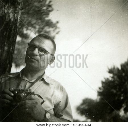 Vintage photo of man with camera (sixties)