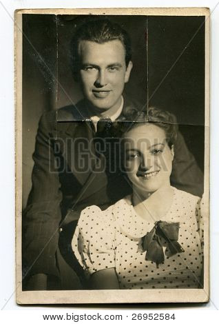 Vintage photo of young couple (cut out after a quarrel)