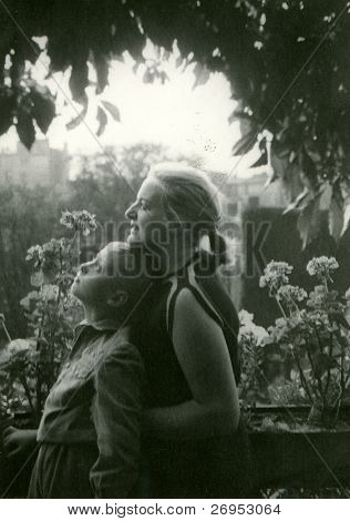 Vintage photo of mother and son (early fifties)