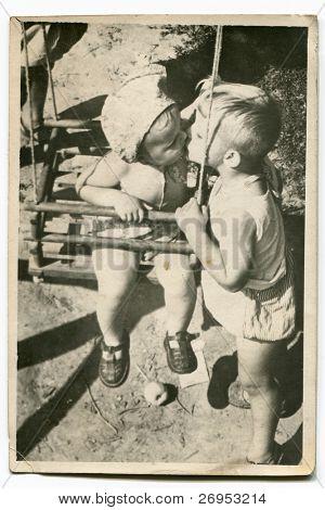 Vintage photo of children kissing