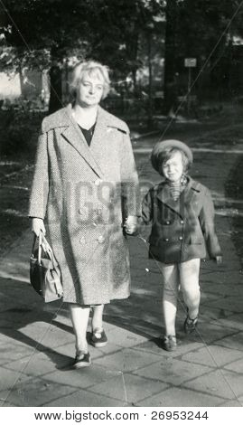 Vintage photo of mother and daughter (lately fifties)