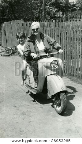 Vintage photo of mother and daughter on scooter (early sixties)