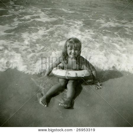 Vintage photo of young girl with life buoy (fifties)