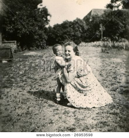 Vintage photo of mother and son (forties)