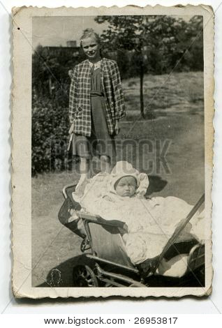 Vintage photo of young aunt and her baby nephew (1950)