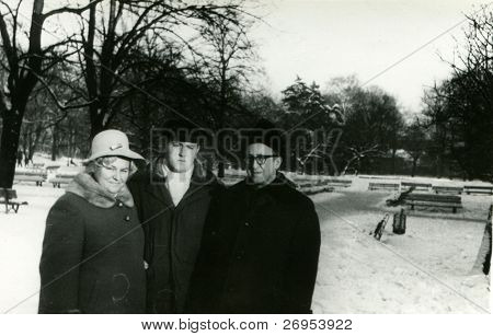Vintage photo of mature couple with son in park (winter) -sixties