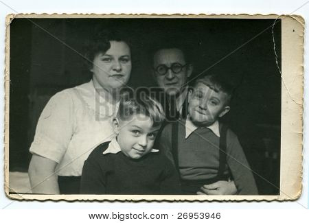 Vintage photo of happy family (fifties)