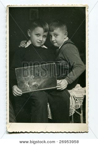 Vintage photo of brothers with a book (fifties)