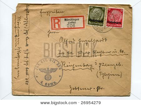 "GERMANY - CIRCA 1940: vintage envelope from register mail with German Reich canceled postal stamps, showing President Paul von Hindenburg, with word ""Lothringen"" imprinted, Germany, circa 1940"