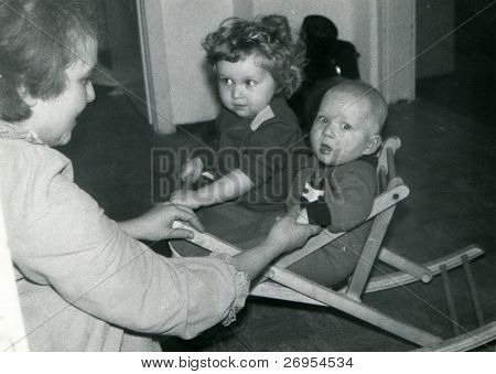 Vintage unretouched photo of mother and children