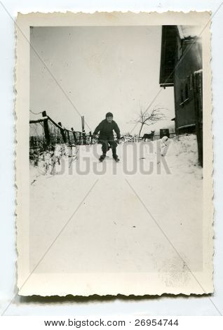 Vintage unretouched photo of boy skiing